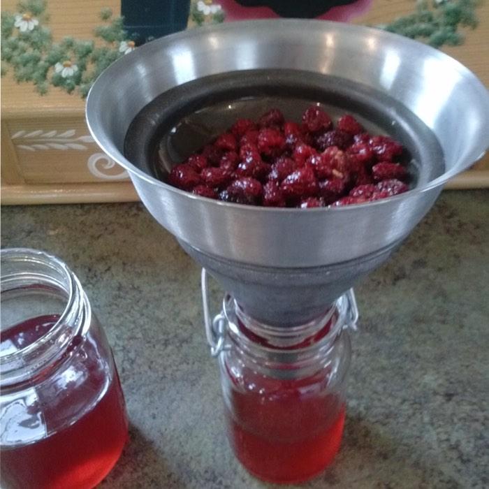 straining raspberries